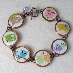 Whimsical Owl bracelet. Fun and colorful owl illustrations. One of four owl bracelets. Handmade Pennies From Heaven Jewelry. See my website for more images. By Cathy Corredor, www.Catbangles.ArtFire.com