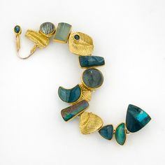 Jeff & Susan Wise at Patina Gallery. Bracelet, Sterling Silver, 18K and 22K Yellow Gold, Faceted and Cabachon Blue/Green Tourmaline, Opal, Blue/Green Jasper.