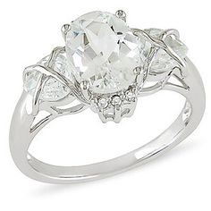 10kt White Gold Diamond Accent and White Topaz Ring hey, topaz can look beautiful too :) Probably an ethical alternative to diamonds as opposed to conflict free that cost ten times as much easily-skip the diamond altogether