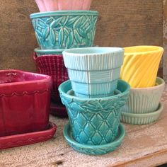 "Vintage McCoy Pots in a rainbow of colors.  I always love playing ""I Spy"" with other people's collections.  How many patterns do you know? ~ Mary Walds Place - I Love Collecting: FLOWER POTS!"