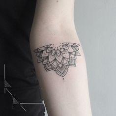 Half mandala tattoo, but on the upper part of my arm