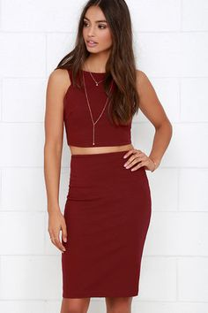 """Get the coveted crop top and matching skirt look in a snap with the Double Entendre Wine Red Two-Piece Dress! This medium-weight stretch knit crop top has a deep sleeveless cut, a bodycon fit, and darted side accents. Matching midi skirt includes a comfortable elastic waistband. Top and skirt have hidden back zippers. Fully lined. Small top measures 14"""" long. Small bottom measures 23"""" long. 62% Viscose, 33% Nylon, 5% Spandex. Lining: 100% Polyester. Dry Clean Only. Made With Love in the…"""