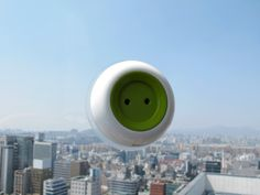 Discreet, cute and as green as it gets: Just stick this portable outlet to your window to start using solar power