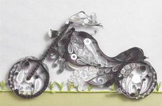 Time for a motorcycle ride. A quilling design by Marjorie Jones