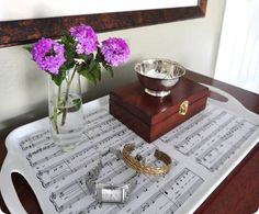 DIY tray using mod podge and sheet music. Pick a sentimental song, favorite poem or quote and personalize the tray to fit your home.
