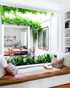 Reading nook overlooking bright inner courtyard.