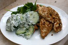 Spice Crusted Chicken with Cucumber, Yoghurt and Mint.     Low fat, low carb, high protein. Uses sesame seeds and almonds in the crust.