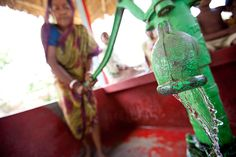 Clean water gushes from a charity: water project in West Bengal, India.