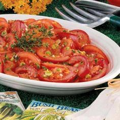 Marinated Garden Tomatoes - always a hit in the summertime!! Serve a dish of these along with those crock-pot hot dogs!!! Don't forget a tray of buns...voila!