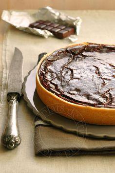 Je dois être dans ma série flan, après celui à la  vanille sans pâte de Michalak , voici une version au chocolat et avec pâte. Je me suis i...