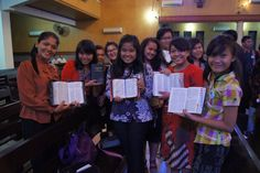 Young ladies ladies holding their copies of the Bible in Indonesia. #Day295 until the Twelfth Assembly #Assembly365 #Lutheran