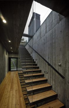 This industrial minimalist house was built in Poland a short distance from the sea by Ultra Architects and features some of my favourite building materials: concrete and vertical timber cladding. The unique design of Seaside House. Architecture Details, Interior Architecture, Interior Design, Concrete Interiors, Stair Detail, Timber Cladding, Timber Stair, Metal Stairs, Modern Stairs