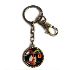 Homestuck Keychain Key Chain Cute Keyring Car Fashion Key Ring God Mandala Art Pendant Cosplay Sollux Aradia. Size:L8X3CM Pendant Size: 2.9CM Colors: Ancient bronze Material:Alloy+Glass.