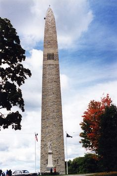 Bennington Battle Monument.  Built in the middle of a Revolutionary War Battle Field.  The Battle of Bennington occurred here in 1777.  The Monument was completed in 1891.  It is 306 feet high and is constructd of blue-grey magnesian limestone from Hudson Falls, New York.  An elevator takes you up to the viewing floor.  The slot windows on each side give a breath taking view.  Three states can be seen from the tower.  Bennington, Vermont.  Photo by Mike Dacy.  October 1995