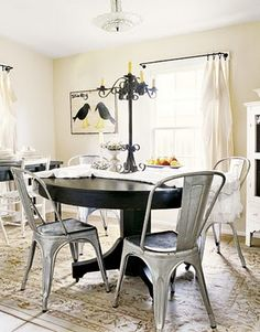 galvanized metal chairs, love the mixed elements of wood, metal and clean white with the punches of black