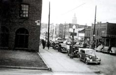 First brick building on the right was Devore's Furniture Shop in 1960. Burned down in 2014 as location of Bon Ton Photography Studio.