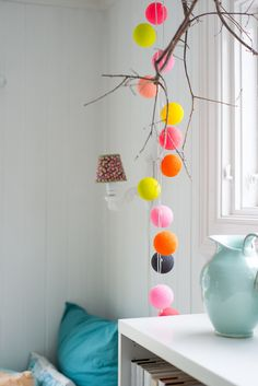close up of colored balls--cover styrofoam balls in yarn and make a garland for the kids' room