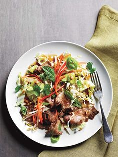 Thinly sliced, perfectly seared steak tops Thai salad of crunchy cabbage, fresh bean sprouts, fragrant basil & mint herbs. Recipe from Chef James Briscione.