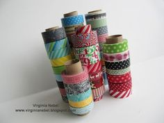 A freebie Washi storage idea, using empty tubes split lengthwise with the tapes stacked on the tubes. organize by color or pattern