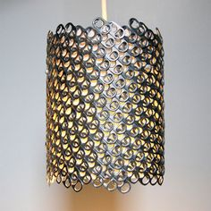 http://www.thebohmerian.com/2012/01/creative-lamps-made-from-recycled-paper-and-soda-can-tabs-by-nyc-based-lighting-designer-allison-patrick/    Soda Can Tab Pendant : By Allison Patrick