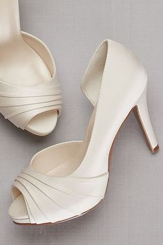 A classic ivory wedding shoe by David's Bridal   Pleated Satin D'Orsay Platform Pumps