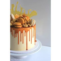 """Chocolate Salted Caramel Cake w caramel ganache drip, caramel popcorn, macaroons and toffee #missmollyscakes #melbournecakes"""