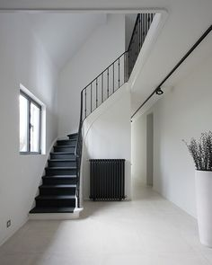 Stairs that start at the base of the window and take a sharp turn up into the attic