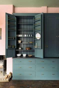 deVOL's gorgeous Classic English countertop cupboards filled with classic Falcon Enamelware