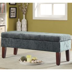 @Overstock.com - Teal Velvet Storage Bed Bench - This vibrant velvet teal storage bench sits atop solid wood legs in a brown finish. The bench features a hinged piano bench-type storage lid.  http://www.overstock.com/Home-Garden/Teal-Velvet-Storage-Bed-Bench/8301356/product.html?CID=214117 $105.29