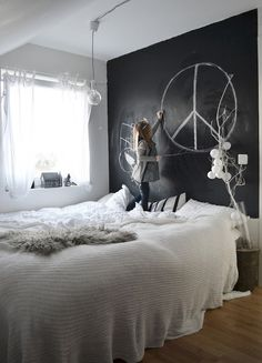 bedroom with gorgeous black chalkboard wall. love it minus the peace sign and the kid :p