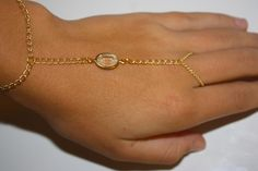Crystal Clear Slave Bracelet, Hand Chain, Ring to Wrist Bracelet, Vintage Rhinestone. $20.00, via Etsy.