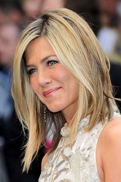 Jennifer Aniston - hair. IF (a big if) I ever went back blonde I'd like it to be something like this.