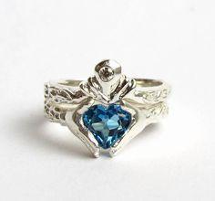 Claddagh Wedding Set  - White Gold and Diamond - Blue Topaz or Red Garnet - Engagement Ring and Wedding Band- Rickson. $1,600.00, via Etsy.