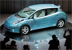 Nissan Shows Off Its Electric Car, the Leaf - NYTimes.com....My new about town car in black.  I LOVE driving it.  No more gas stations, no oil changes, no emissions test.  Check out the rebates.