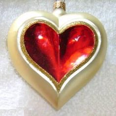 AN OPEN GOLD HEART WITH RED INSIDE. VERY PRETTY.