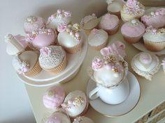 Vintage Inspired Pink Cupcakes pink vintage cake pretty roses pearls cupcake bows cake decorating