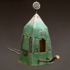 Ceramic birdhouse.