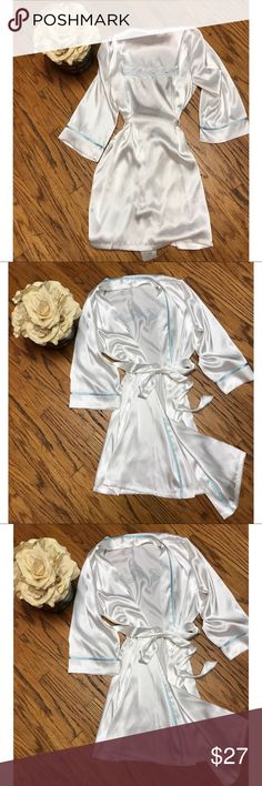 """Bride Linea Donatella Robe 👰🏻 Picture sitting in your bridal suite wearing this beautiful Robe while getting ready for your big day !! Size s/m sky blue trim with """"The Bride"""" on the back in the same blue . Just gorgeous ! linea donatella Intimates & Sleepwear Robes"""