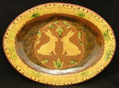 Redware Oval Platter, Rabbits with Leaves, reproduction 1850 pattern.