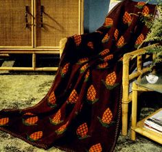 Pineapple Afghan knit pattern from Afghans & Matching Pillows, originally published by Coats & Clark, Book 505, in 1954.