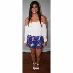Royal Blue Floral Shorts with Lace A gorgeous pair of shorts topped off with lace and a floral print! Nothing screams summer and tan legs more than these shorts. Shorts