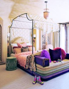 Willow Smith's Regal Bedroom // polka dot canopy, iron four-poster bed, pink and purple fur throw pillows, tufted ottoman,