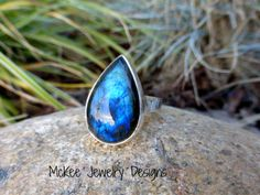 Size of ring is 7 1/2 This beautiful ring is made with fine silver and sterling silver. We metal smithed in our studio, with a large Labradorite gemstone, which is 22mm by 13mm teardrop shape aprox an