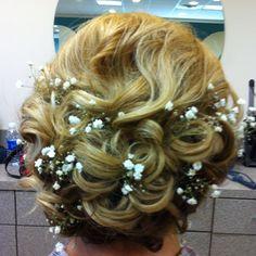 Wedding hair!  I think I like the babysbreath.