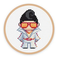 In his spandex jumpsuit and aviator shades, LeRoy often gets mistaken for the King. Show him some love in this cross-stitch pattern by iamnotadoll.