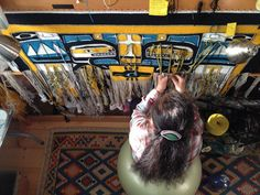 """Clarissa Rizal weaving the """"Resilience"""" Chilkat robe she designed and wove, recently completed in June 2014"""