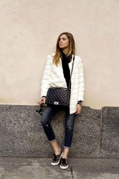 The Blonde Salad styles a white fur coat with cropped jeans and leopard print sneakers.