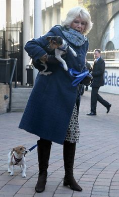 Camilla, Duchess of Cornwall arrives at Battersea Dog and Cats Home with her two Jack Russell terriers Beth and Bluebell on 12 Dec 2012 in London