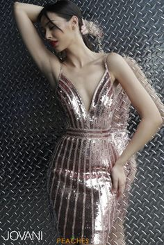 6071979615 Jovani 62478 A gorgeous and unique rose gold sequin fabric cocktail dress.  Features a plunging deep V neckline and open back. TBC Occasions
