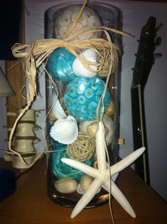 Fill dollar store vases with shells for beach bathroom